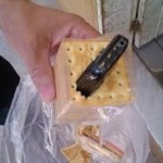 Celular foi encontrado dentro de pacote de bolachas no presidio de Caicó.